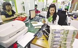 """NHNN """"nhắc nhở"""" Vietcombank tham gia tái cơ cấu ngân hàng nhỏ"""