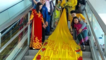 """Cặp đôi Thanh Bạch - Thúy Nga bị """"ném đá"""" phản đối vì diện áo dài 5m lên máy bay"""